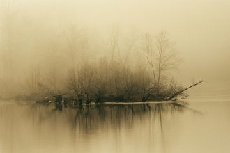 fog-hovers-above-the-james-river-raymond-gehman